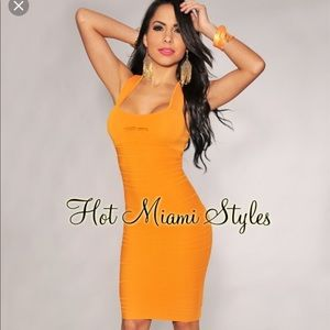 Hot Miami Styles Tangerine Peep Hole Bandage Dress
